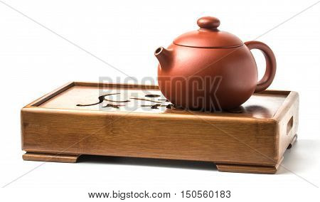 Traditional chinese tea ceremony accessories. Tea pot on the tea table