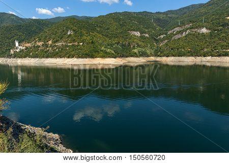 Green forest around Vacha (Antonivanovtsy) Reservoir, Rhodopes Mountain, Bulgaria