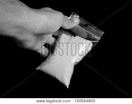 Men holding bag with cocaine drug powder, men selling drugs junkie in black and white colors