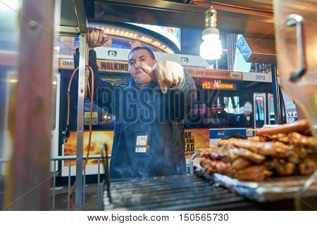 NEW YORK - CIRCA MARCH, 2016: street vendor in New York City. Street food is ready-to-eat food or drink sold by a hawker, or vendor, in a street or other public place, such as at a market or fair.