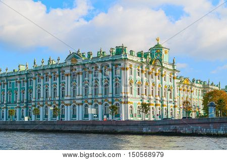 ST PETERSBURG RUSSIA-OCTOBER 3 2016. Winter Palace on the embankment of Neva river in St PetersburgRussia. Architecture landmark of St Petersburg in autumn sunny day. Closeup facade view