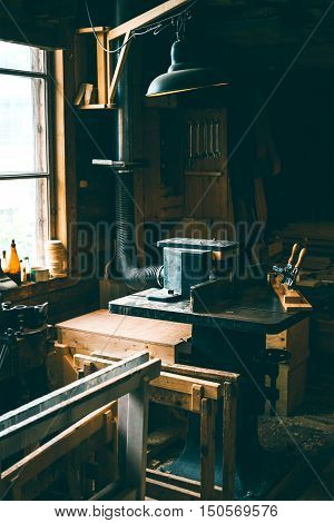 old carpenter's tools for working with wood workshop