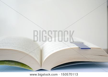 Open book with a bookmark and copy-space