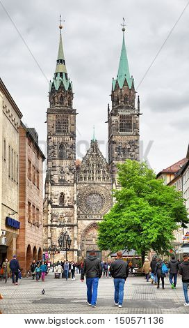 NUREMBERG, GERMANY - May 17, 2016: View of Karolinenstrasse and St. Lawrence church in Nuremberg