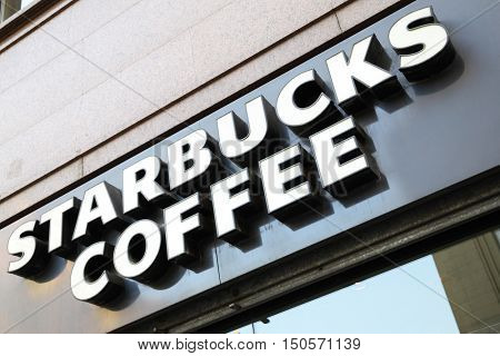 MADRID, SPAIN - September 06, 2016: Starbucks coffee shop sign close-up. Starbucks is the largest coffeehouse in the world