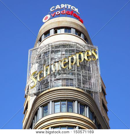 MADRID, SPAIN - September 06, 2016: Top of the Capitol building with neon sign in Madrid