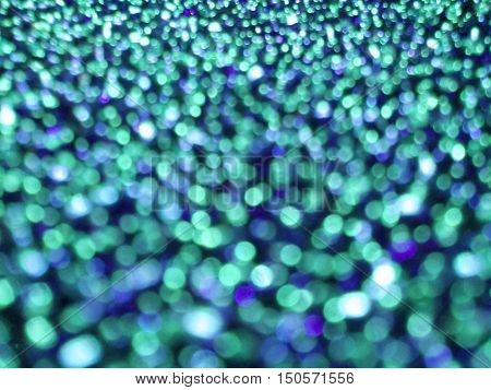 Colorful bright twinkling lights. Abstract texture background.