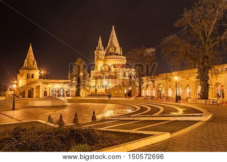 Night view of the Fisherman's Castle is a terrace in neo-Gothic and neo-Romanesque style situated on the Buda bank of the Danube in Budapest Hungary.