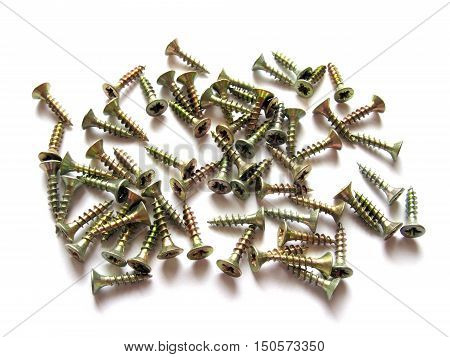 Screws isolated on white background. Screws on white background. Scattered screws. Construction and repair.