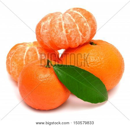 Mandarin with leaf and slices of peeled tangerine isolated on white background