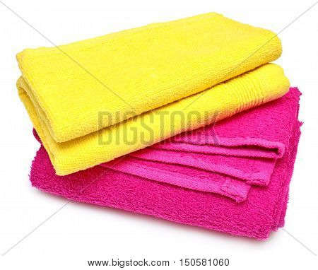 Two towels yellow and pink towel isolated on white background