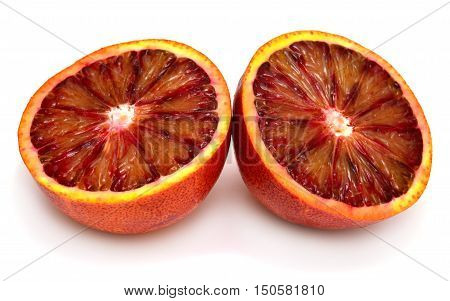 Sicilian orange cut in half in two isolated on white background