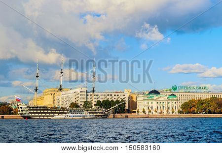 ST PETERSBURG RUSSIA-OCTOBER 3 2016. Architecture landmarks of Petrovsky embankment in St Petersburg Russia - old historical buildings and frigate Grace at Neva river in autumn nice weather
