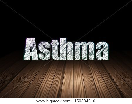 Healthcare concept: Glowing text Asthma in grunge dark room with Wooden Floor, black background