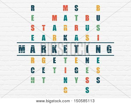 Advertising concept: Painted blue word Marketing in solving Crossword Puzzle