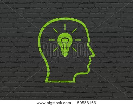 Advertising concept: Painted green Head With Lightbulb icon on Black Brick wall background