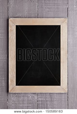 Wooden school blackboard for chalk writing on wood background