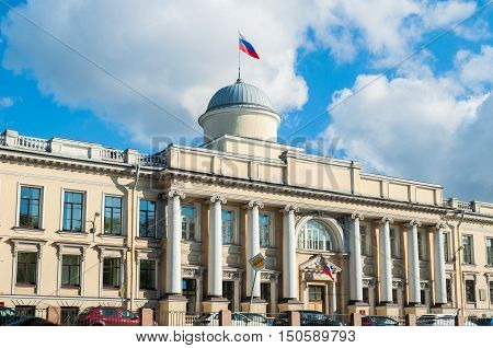 Leningrad Regional Court building - former building of the Imperial College of Law - on the Fontanka River embankment in St Petersburg Russia - facade view with Russian flag on the roof flagpole