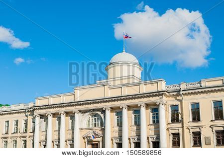 Leningrad Regional Court building on the Fontanka River in St Petersburg Russia - facade view with Russian flag on the roof flagpole in sunny day