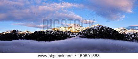 Sunrise Illuminates the Peak of Mt Rolleston and Colorful Clouds.  Temple Basin, Arthurs Pass, Canterbury, New Zealand.