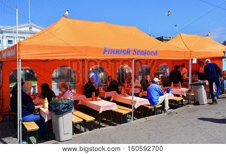 HELSINKI, FINLAND - JUNE, 2016 : Food vendors line the docks at the Helsinki harbor and are a major tourist attraction.