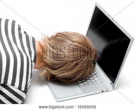 A man sleeping on his laptop
