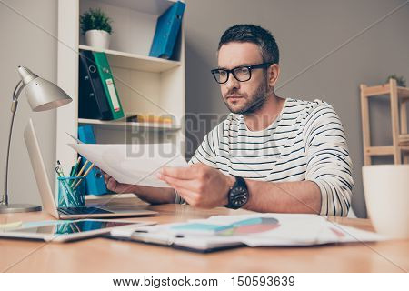 Serious Mature Man Work With Paper In Office