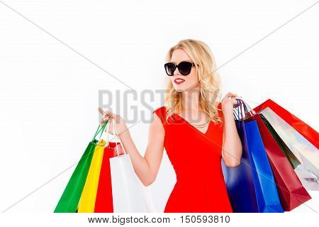 Portrait Of Glamour Lady In Glasses With Packets After Shopping