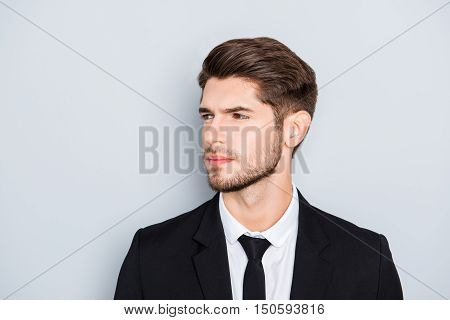 Portrait Of Handsome Bearded Man Wearing Black Suit