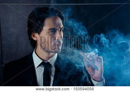 Portrait Of Brutal Handsome Man Think And Smok A Cigar