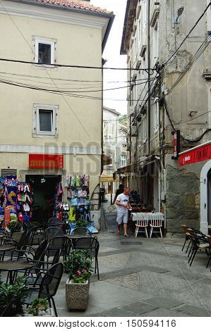 Senj Croatia - September 16 2016: old city. A small town in northern Croatia located on the Adriatic coast. The oldest parts of buildings in the old town come from the fifteenth century. You can see narrow streets pubs restaurants and some tourists.