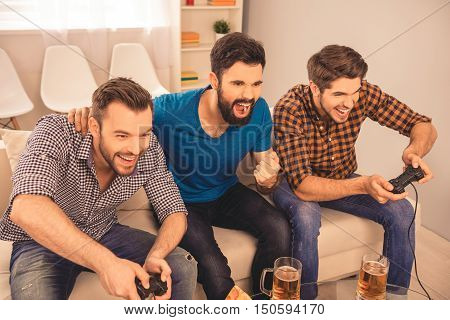 Portrait Of Happy Handsome Men Playing Video Game With His Friends