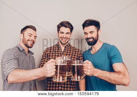 Cheers ! Three Cheerful Young Men With Glasses Of Beer