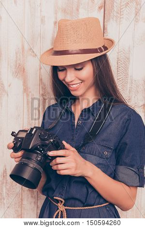 Professional Happy Photographer Holding Camera And Looking On Photos