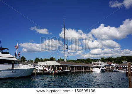 HARBOR SPRINGS, MICHIGAN / UNITED STATES - AUGUST 1, 2016: Yachts are moored at the Walstrom Marine dock in Harbor Springs.
