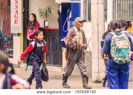 Banos De Agua Santa Ecuador - 23 June 2016:Unidentified Ecuadorian People Walking On The Streets Of Banos De Agua Santa Ecuador South America