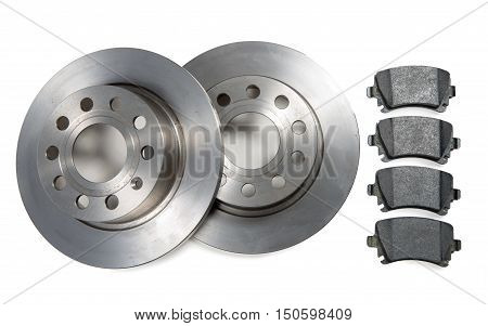 a pair of car brake discs and pads on white background
