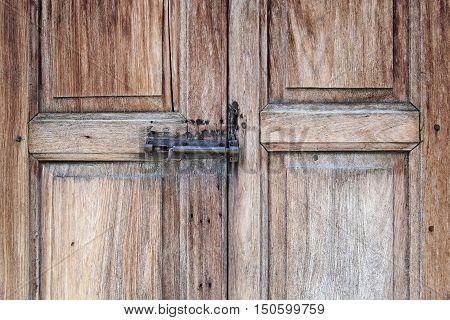 Old Door Bolted On Wooden Door