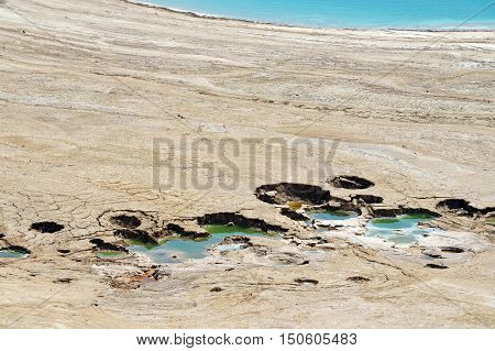 Aerial landscape view of Sinkholes in the Dead Sea Israel.