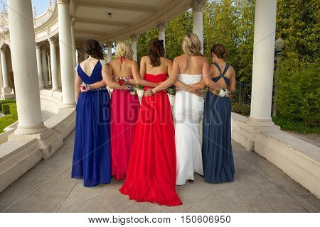 Prom girls walking away so you can see the back of their dresses