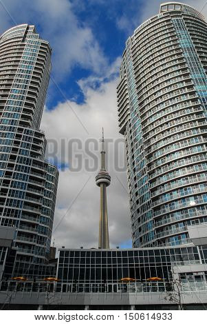 Toronto Canada - January 2 2007: CN Tower in the middle of two residential buildings seen in Toronto's harbor front on a beautiful day.