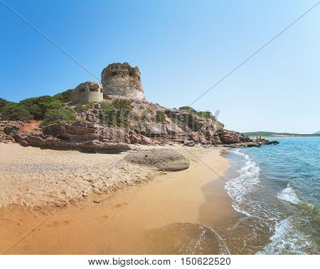 Ruins of Ancient Watchtower (Nuraghe) on the Hill over the Porto Ferro Beach near Alghero Province of Sassari Sardinia Italy