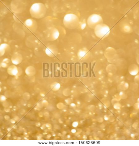 Festive blur background. Abstract twinkled bright background with bokeh defocused golden lights. Christmas blurry boke lights