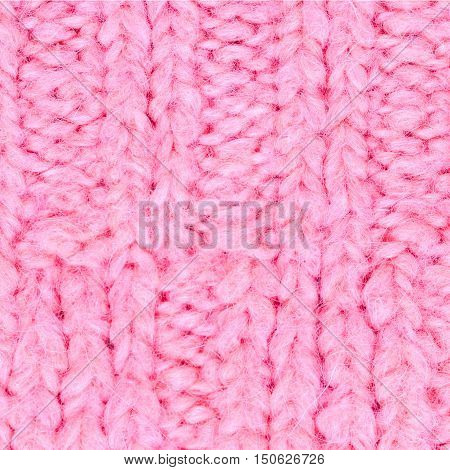 Pink knitting wool texture background. Colorful knitted horizontal textured background. Christmas and New Year Design Background