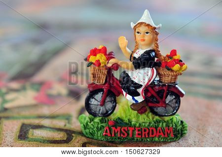 typical dutch souvenir of a Dutch girl on a table of a cafe / restaurant the city Amsterdam Netherlands.