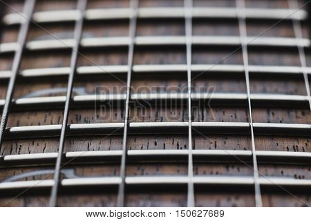Electric guitar rosewood fretboard and strings close-up