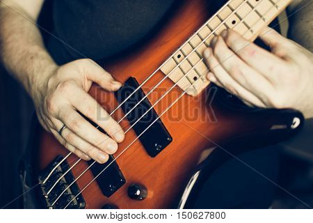 Musician Playing Electric Bass Guitar