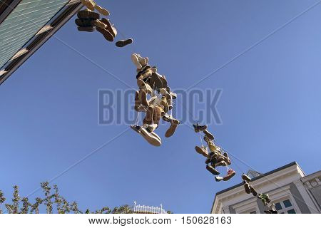FLENSBURG GERMANY - OCTOBER 4 2016: Old shoes thrown into the air and locked on telephone cable as a joke in Flensburg October 4 2016.