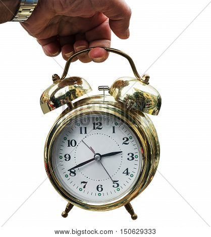 vintage clock alarm clock golden hand holding on the white background