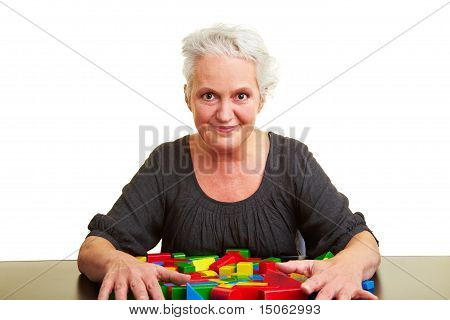 Senior Woman With Many Building Blocks
